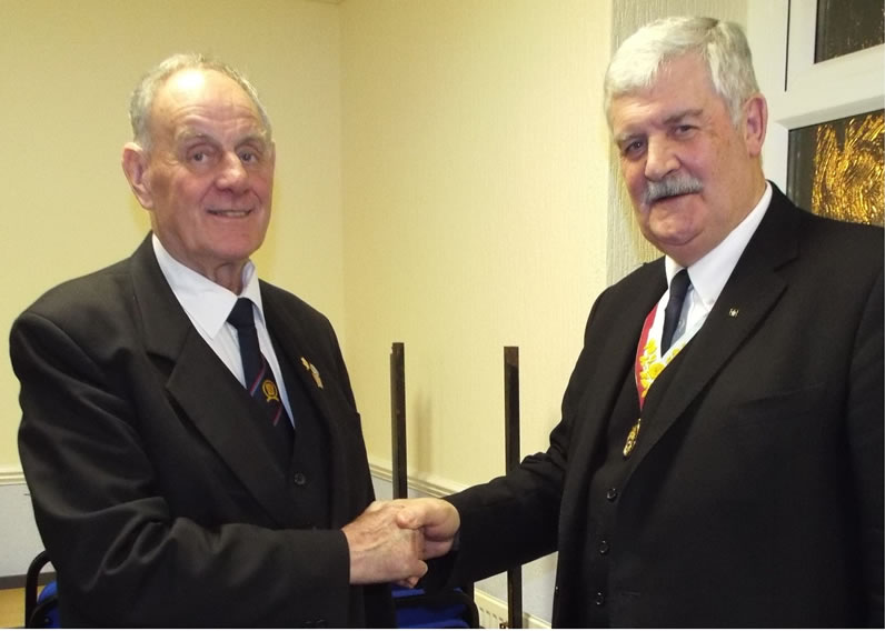W.Bro Byron being congratulated on his accomplishment of 50 yrs by the Provincial Grand Master